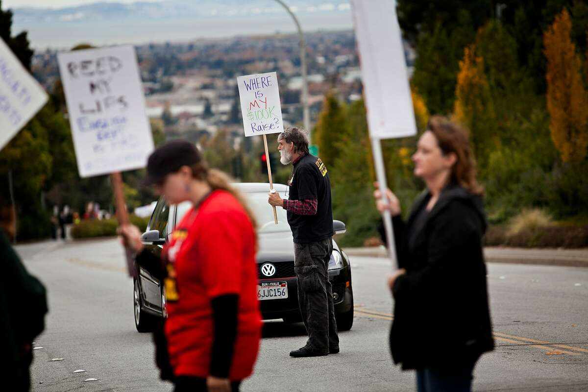 A protester blocks a car from crossing the picket line on Carlos Bee Boulevard in Hayward Thursday November 17, 2011, as part of a strike protesting for faculty pay adjustments. Jason Henry/Special to The Chronicle