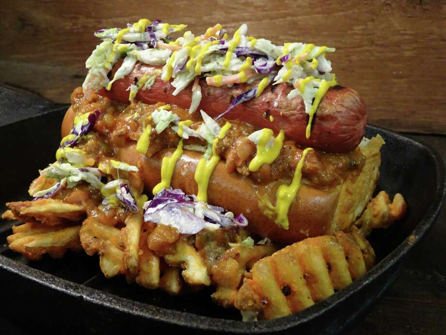 Toyota Center has a new menu, which includes this mammoth Clutch City Dog. Photo: Jimmy Coatsworth
