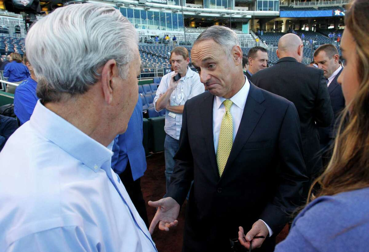 4692 x 3204~~$~~Major League Baseball Commissioner Rob Manfred talks with Kansas City Royals owner David Glass, left, before Game 5 in baseball's American League Division Series between the Royals and the Houston Astros, Wednesday, Oct. 14, 2015, in Kansas City, Mo.