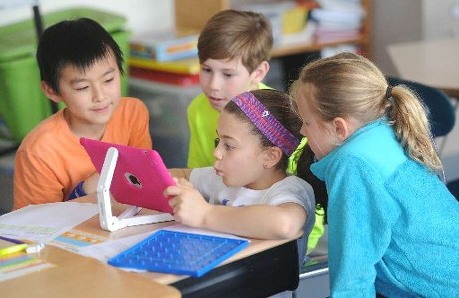 All Greenwich elementary students have received their own iPads, as part of the district's digital learning initiative. All middle school and Greenwich High School students have Chromebook laptops. Photo: Contributed Photo