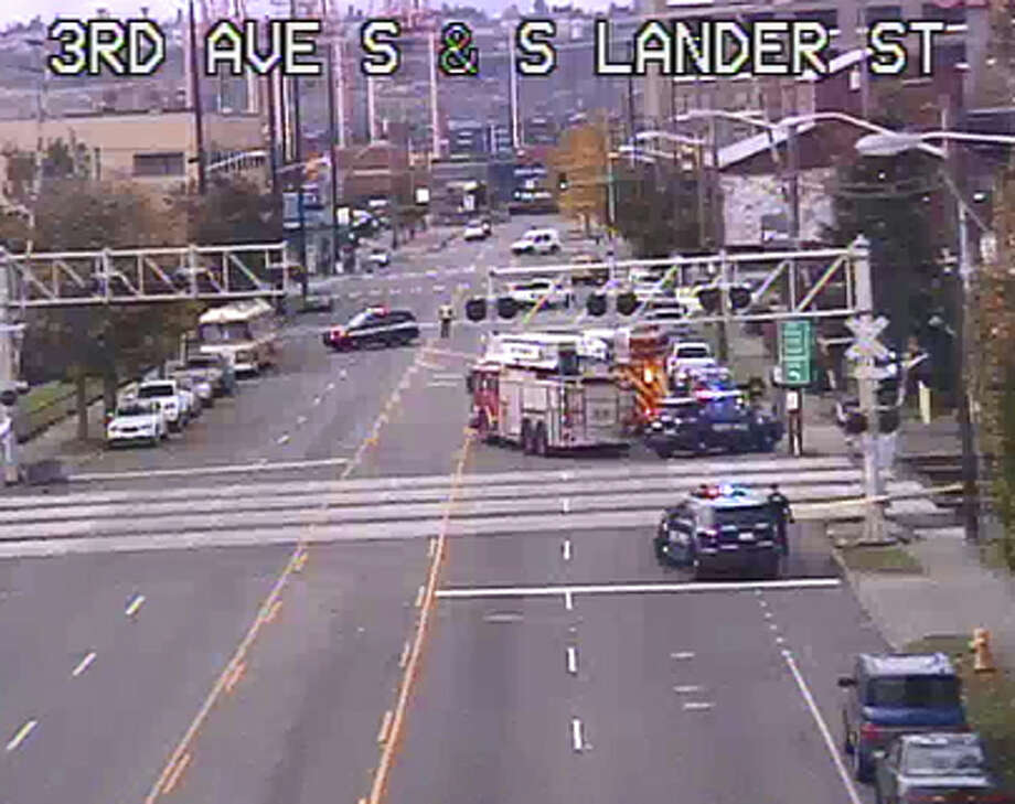 Seattle police investigate a train hitting a pedestrian Monday in Sodo. Both directions of South Lander Street were blocked for the response. Photo: SDOT