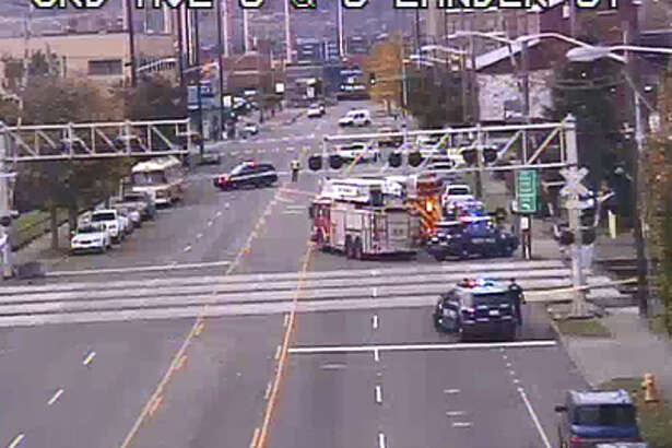 Seattle police investigate a train hitting a pedestrian Monday in Sodo. Both directions of South Lander Street were blocked for the response.