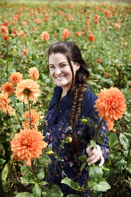 Christina Stembel, owner and founder of Farmgirl Flowers, in a field of dahlias at Figone Nursery in Half Moon Bay. Photo: Michael Short, Special To The Chronicle