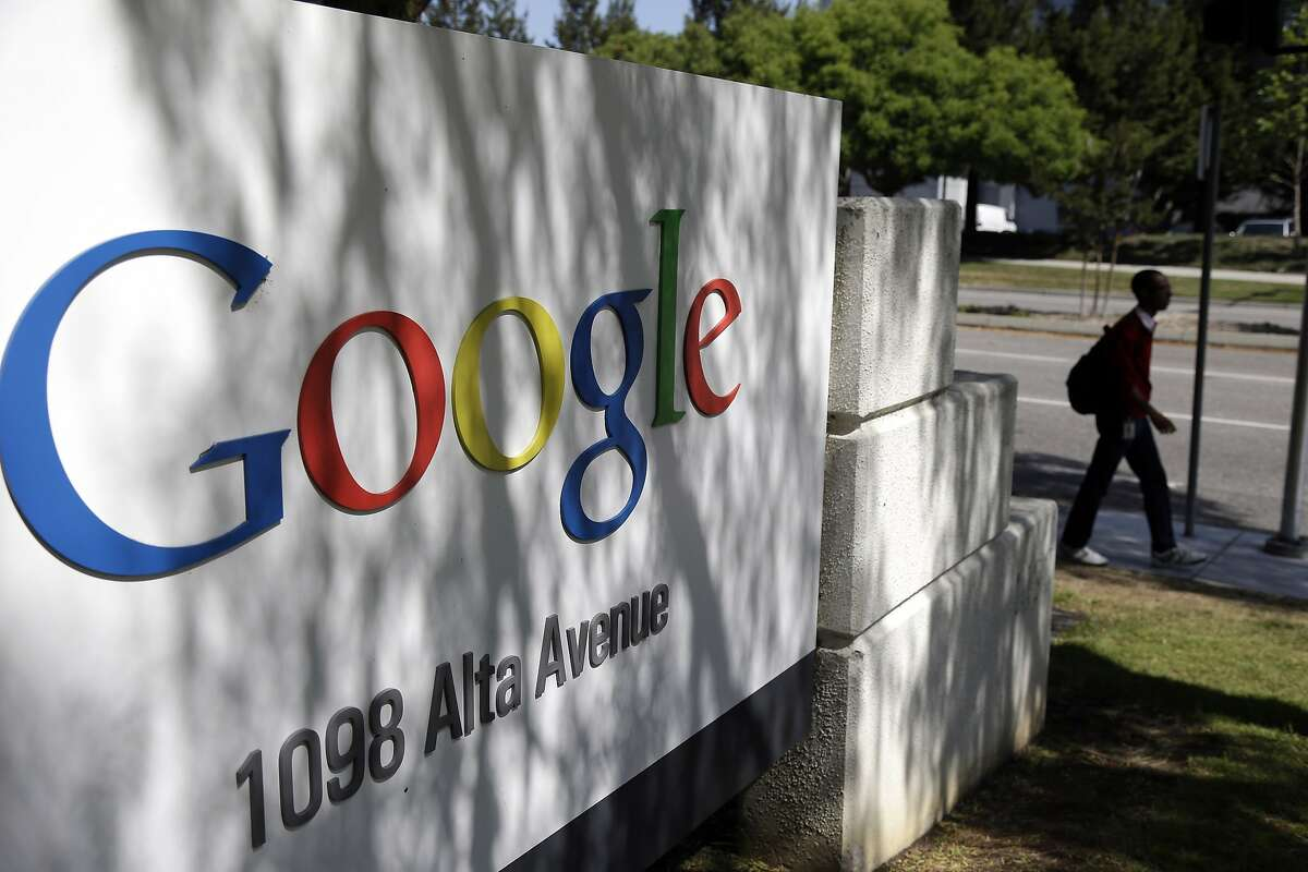 A man walks past a Google sign at the company's headquarters in Mountain View, Calif. (AP Photo/Marcio Jose Sanchez, File)