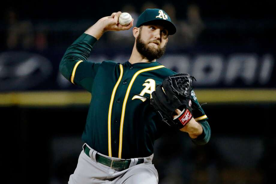 CHICAGO, IL - Cody Martin #63 of the Oakland Athletics pitches against the Chicago White Sox during the first inning at U.S. Cellular Field on September 16, 2015. (Photo by Jon Durr/Getty Images)