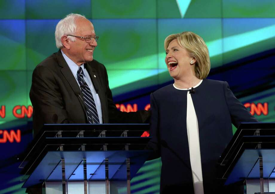 Democratic presidential candidates Bernie Sanders and Hillary Clinton participated in a debate which, according to a reader, was more substantive than the GOP debates. Photo: Joe Raedle / / 2015 Getty Images