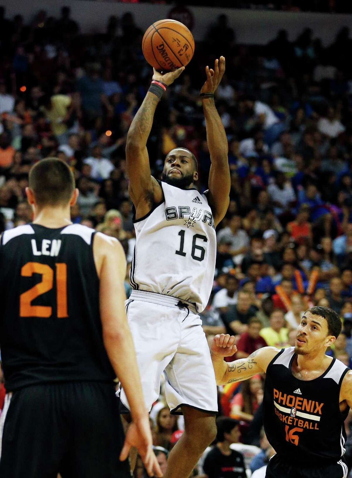 San Antonio Spurs Jonathon Simmons shoots against the Phoenix Suns during the first half of an NBA summer league game on July 20, 2015, in Las Vegas. (AP Photo/John Locher)