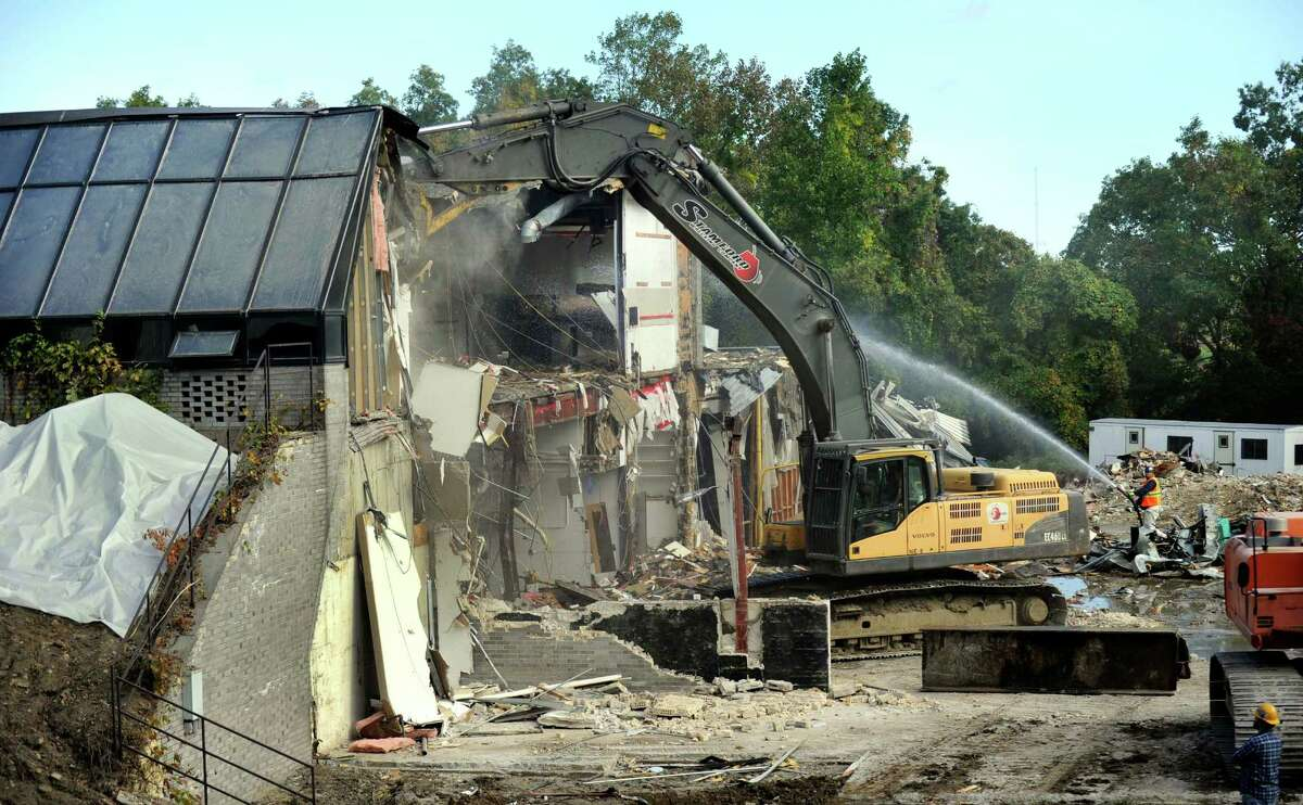 An office building at the old Schlumberger property in Ridgefield, purchased by the town in 2012, is torn down Wednesday, Oct. 7, 2015.