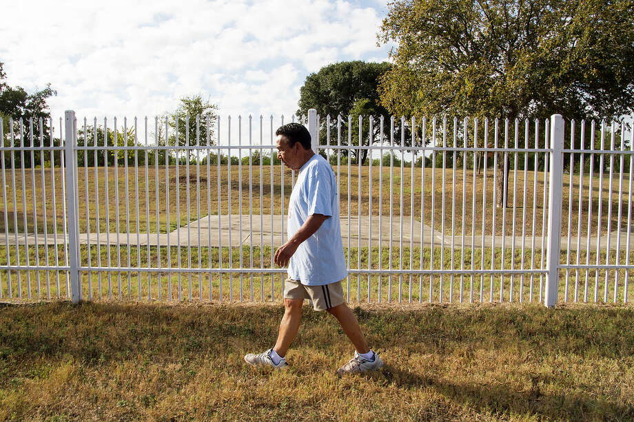 Eusebio Perez, 82, taking a walk near his home, Friday, Oct. 16, 2015. At 82, Perez walks every morning and has participated in the San Antonio Senior Games since 1985 in basketball, shot put, javelin, the broad jump and the long jump. Photo: Alma E. Hernandez, For The San Antonio Express News / Alma E. Hernandez / For The San