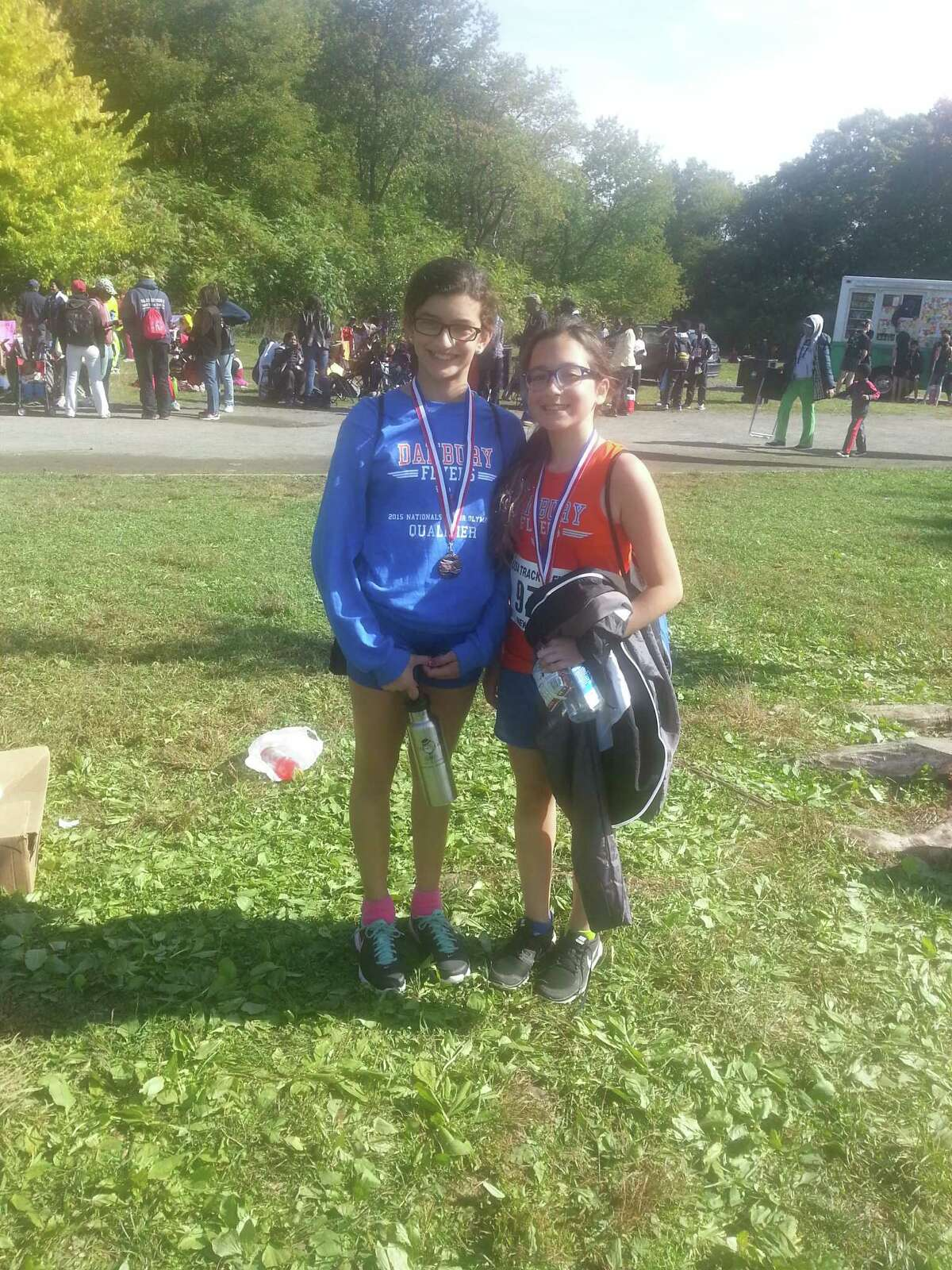 Danbury Flyers medalists Gabriella Teixeira (left) and Valerie Fox at their race on Oct. 11, 2015.