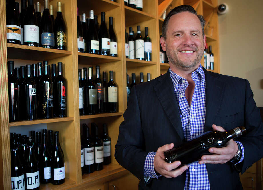 Shade sommelier Sean Essex holds a bottle of Ehlers Estate wine at Shade, Thursday, Oct. 15, 2015, in Houston. (Cody Duty / Houston Chronicle) Photo: Cody Duty, Staff / © 2015 Houston Chronicle