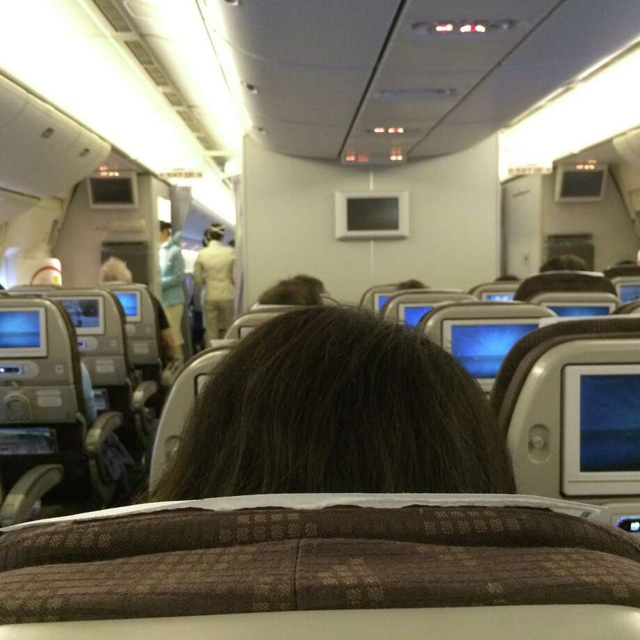 The world from an  airline seat, economy Photo: Kevin Schafer / Getty Images / This image is subject to copyright.
