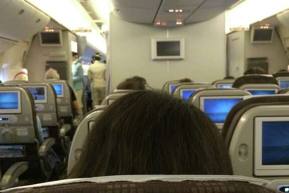 The world from an  airline seat, economy