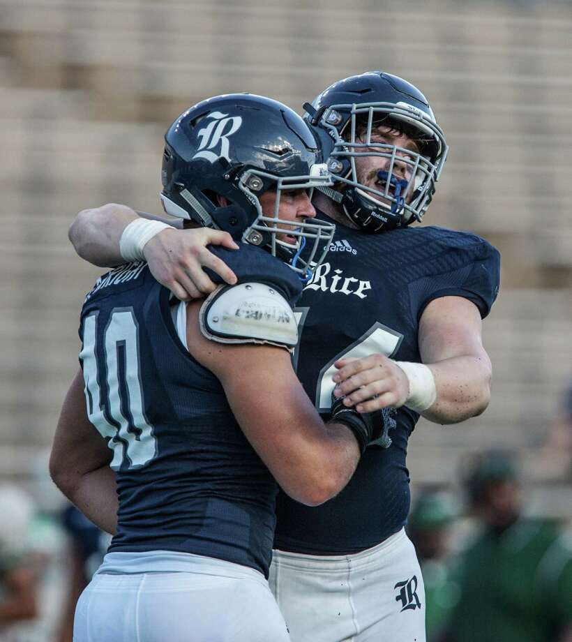 Brady Wright and Brian Womac celebrate after a play during a game against Wagner Saturday September 5th, 2015. The Rice Owls defeated the Wagner Seahawks 56-16. (Michael Starghill, Jr.) Photo: Michael Starghill, Jr., Photographer / © Michael Starghill, Jr.