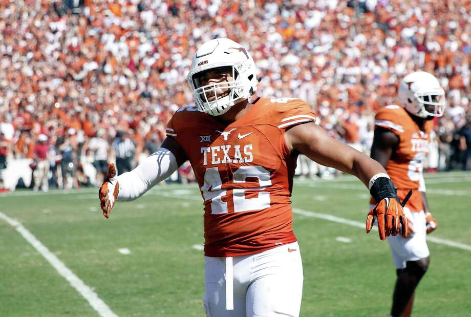 Texas tight end Caleb Bluiett celebrates in the victory against Oklahoma on Oct. 10, 2015, at the Cotton Bowl in Dallas. Photo: Roger Steinman /Associated Press / FR171255 AP