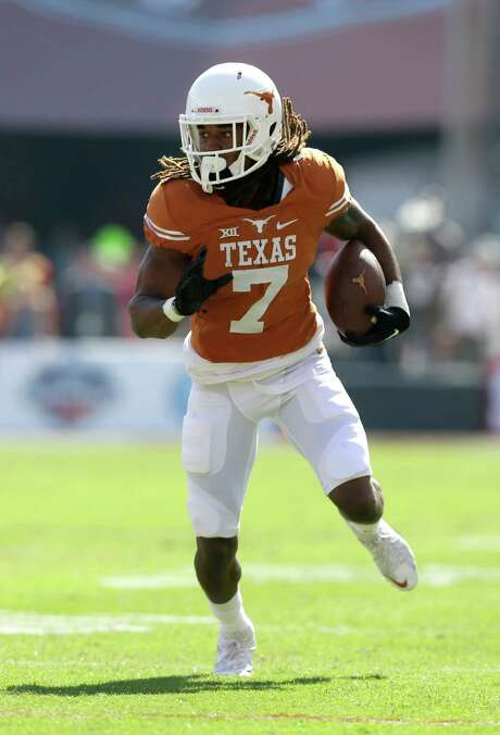 Texas wide receiver Marcus Johnson (7) looks for running room in an NCAA college football game against Oklahoma Saturday, Oct. 10, 2015, in Dallas. (AP Photo/LM Otero) Photo: LM Otero, STF / AP