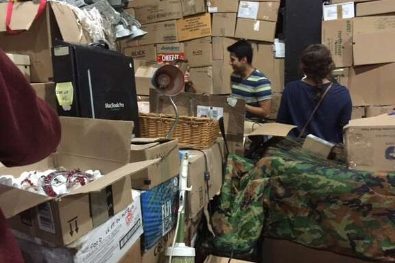 Theater-goers rummage through the boxes at Curran