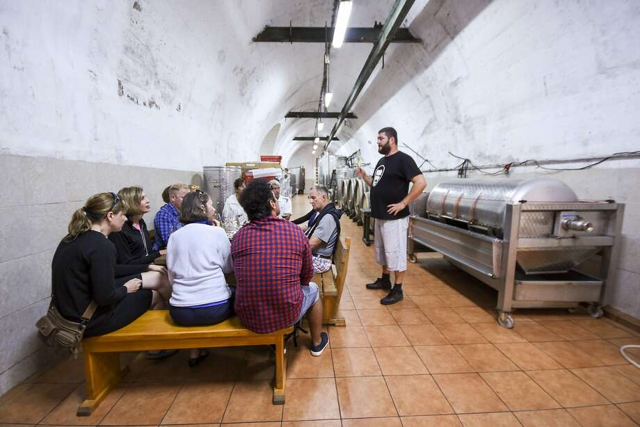 Antonio Lipanovic offers a tasting in his Lipanovic Winery cellars on Vis Island in Croatia. The site was originally an underground military installation. Photo: Margo Pfeiff, Special To The Chronicle