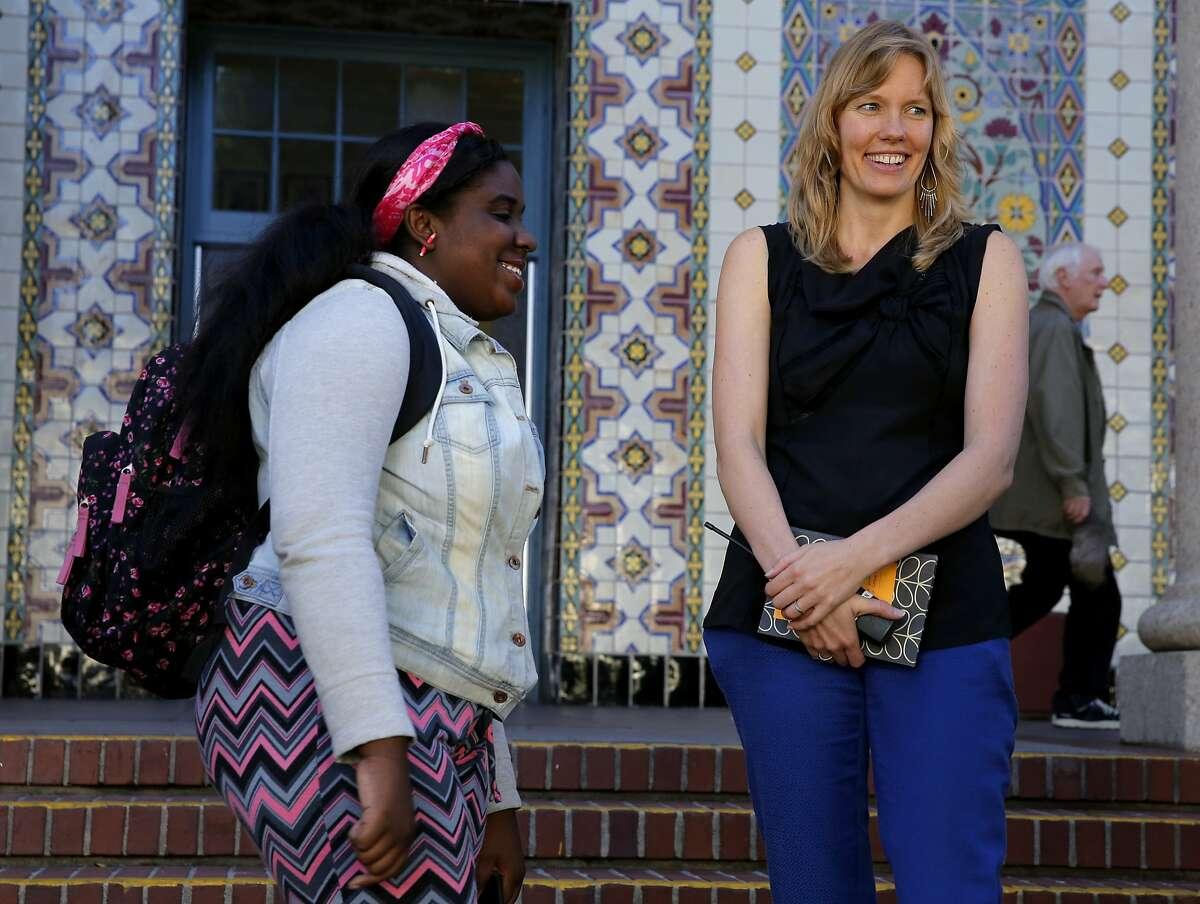 Principal Lena Van Haren (right) speaks with former student Kayla Rash outside Everett Middle School in San Francisco, California, on Monday, Oct. 19, 2015.