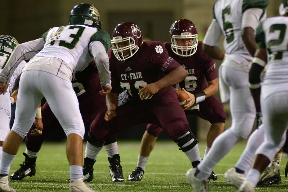 After spending 2014 on Cy-Fair's junior varsity, senior center David Phillips (78) has earned a starting role that includes helping protect QB Hayden Wesneski (16). Photo: Jerry Baker, Freelance
