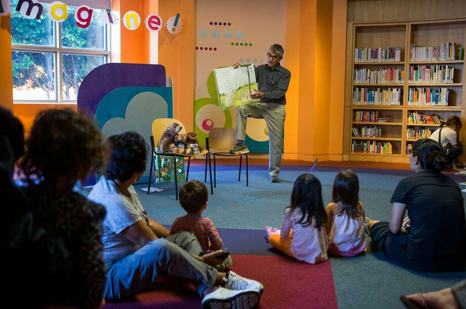 Children's librarian Timothy Troy reads a book to toddlers during reading time in the Children Center at San Francisco's main library on Monday, Oct. 19, 2015 in San Francisco, Calif. Photo: Nathaniel Y. Downes, The Chronicle