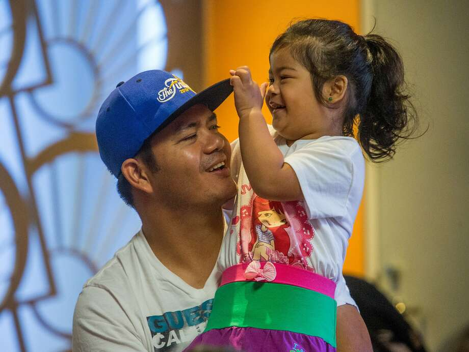 Nino Joseph Cunan holds his daughter Kimberly Franceska, 3, during the toddlers reading time in the Children Center at San Francisco's main library on Monday, Oct. 19, 2015 in San Francisco, Calif. Photo: Nathaniel Y. Downes, The Chronicle