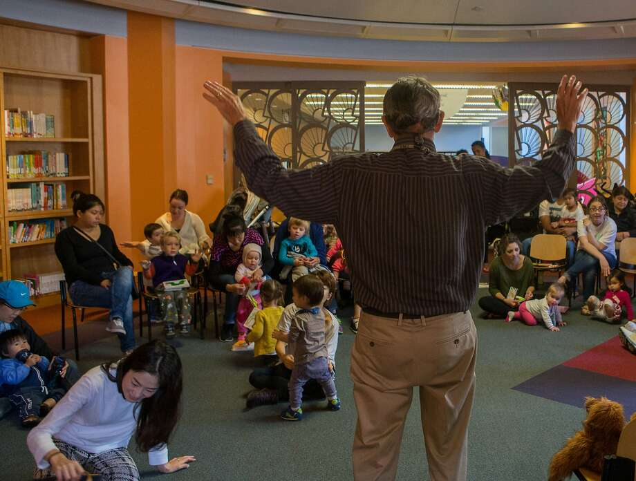 Children's librarian Timothy Troy sings a song to toddlers during reading time in the Children Center at San Francisco's main library on Monday, Oct. 19, 2015 in San Francisco, Calif. Photo: Nathaniel Y. Downes, The Chronicle