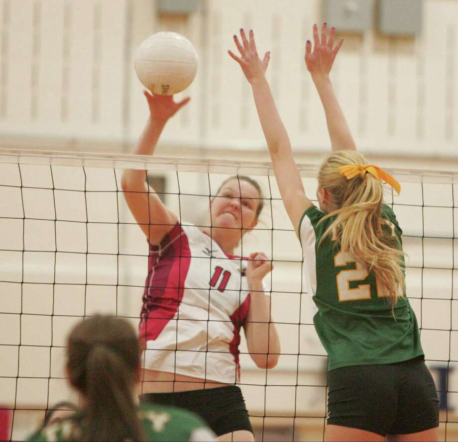 Greenwich's Abbie Wolf makes a hard return past the reach of Trinty's Riley Griffen in the second match. Greenwich went on to sweep Trinity Catholic, 25-21, 25-10, 25-12, in a varsity girls volleyball match on Oct.19, 2015 in Greenwich. Photo: Matthew Brown / For Hearst Connecticut Media / Connecticut Post Freelance