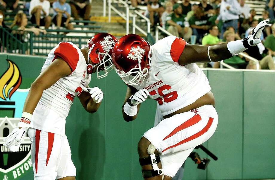 Chance Allen, left, Damien Parris and the rest of the Cougars have been having fun this season, but the heavy lifting on the schedule arrives in November. Photo: Sean Gardner, Stringer / 2015 Getty Images