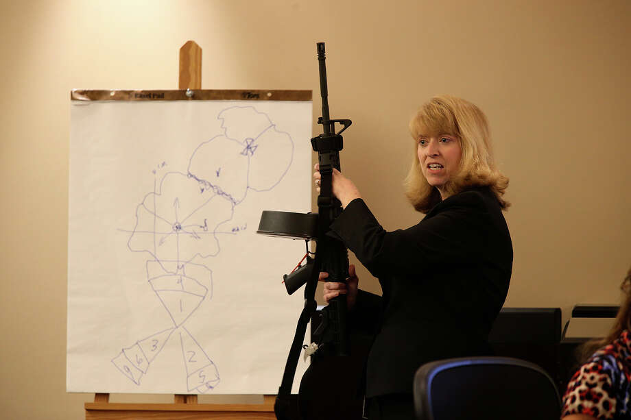 Prosecutor Julie Wright brings out the weapon used in the murder of Bexar County SheriffÕs Sgt. Kenneth Vann, during closing arguments in the punishment phase of the capital murder trial of Mark Anthony Gonzalez in the Bexar County 175th State Criminal District Court, Monday, Oct. 19, 2015. Gonzalez was convicted in the VannÕs murder in May of 2011. Photo: JERRY LARA, Staff / San Antonio Express-News / © 2015 San Antonio Express-News