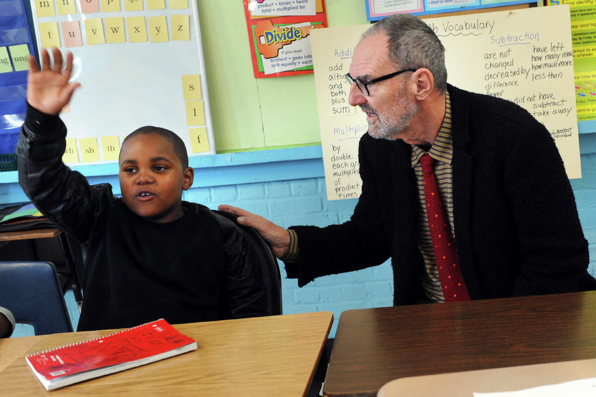 Architect Thom Mayne listens as Jordan Hill, a 3rd grader answers a question at Hall School, left inset. Mayne will be the visiting artist this school year at Hall, part of the national Turnaround Arts program.