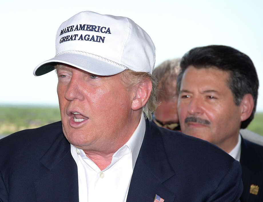 Donald Trump — Laredo Mayor Pete Saenz is behind him — talks to reporters at the World Trade Bridge in July. Photo: Cuate Santos /Laredo Morning Times / LAREDO MORNING TIMES