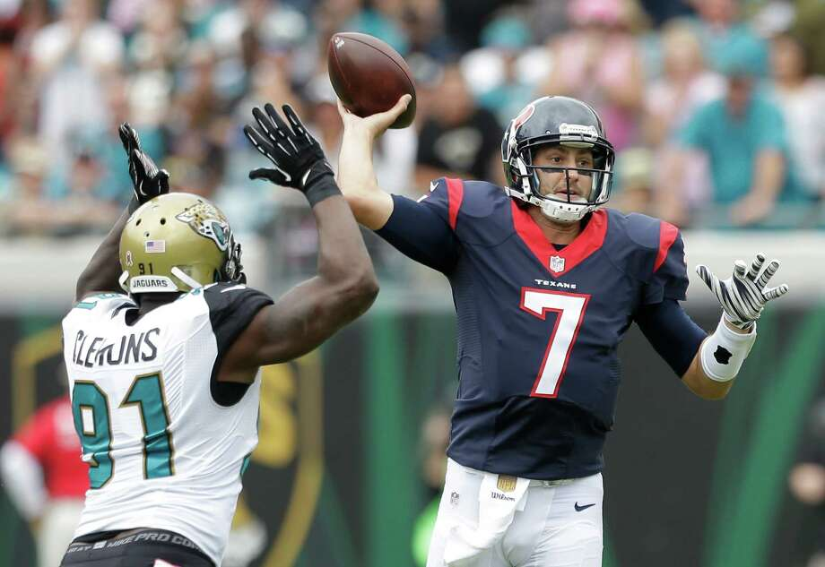 After Sunday's winning performance over Chris Clemons (91) and the Jaguars, the Texans' Brian Hoyer has the seventh-beat QB rating in the NFL at 103. Photo: Brett Coomer, Staff / © 2015  Houston Chronicle