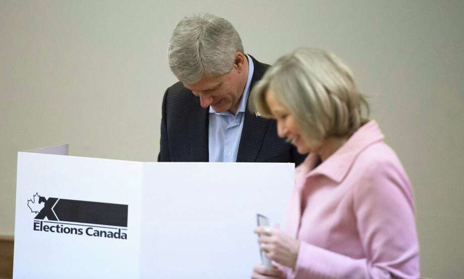 Conservative leader, Prime Minister Stephen Harper and his wife Laureen vote in Calgary, Alberta on Monday, Oct. 19, 2015. Canadians voted Monday to decide whether to extend Harper's near-decade in power or return Canada to its more liberal roots. (Jonathan Hayward/The Canadian Press via AP) MANDATORY CREDIT Photo: Jonathan Hayward, SUB / The Canadian Press