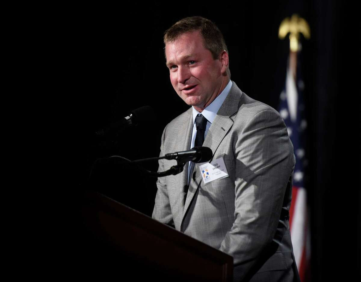 Ted Drury accepts an award for his induction into the Jackie Robinson Professional Wing of the Fairfield County Sports Hall of Fame on Monday.