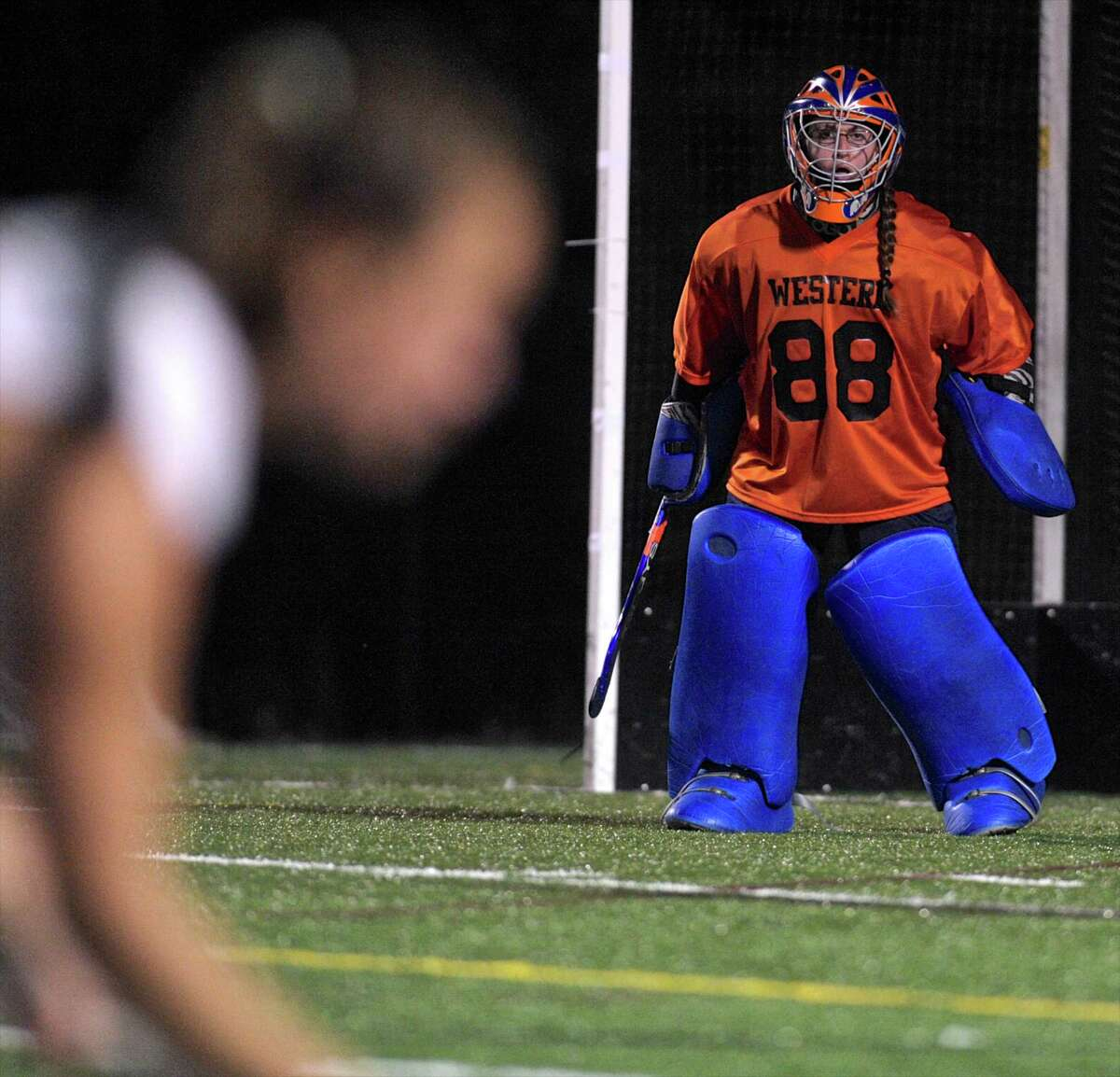 FILE PHOTO: Western's goalie Kristy Trotta (88) watches as New Paltz starts a play after a whistle near the Western goal during the SUNY New Paltz Hawks, Western Connecticut State University Colonials field hockey game on Tuesday, September 1, 2015, at the WCSU Westside Athletic Complex in Danbury, Conn.