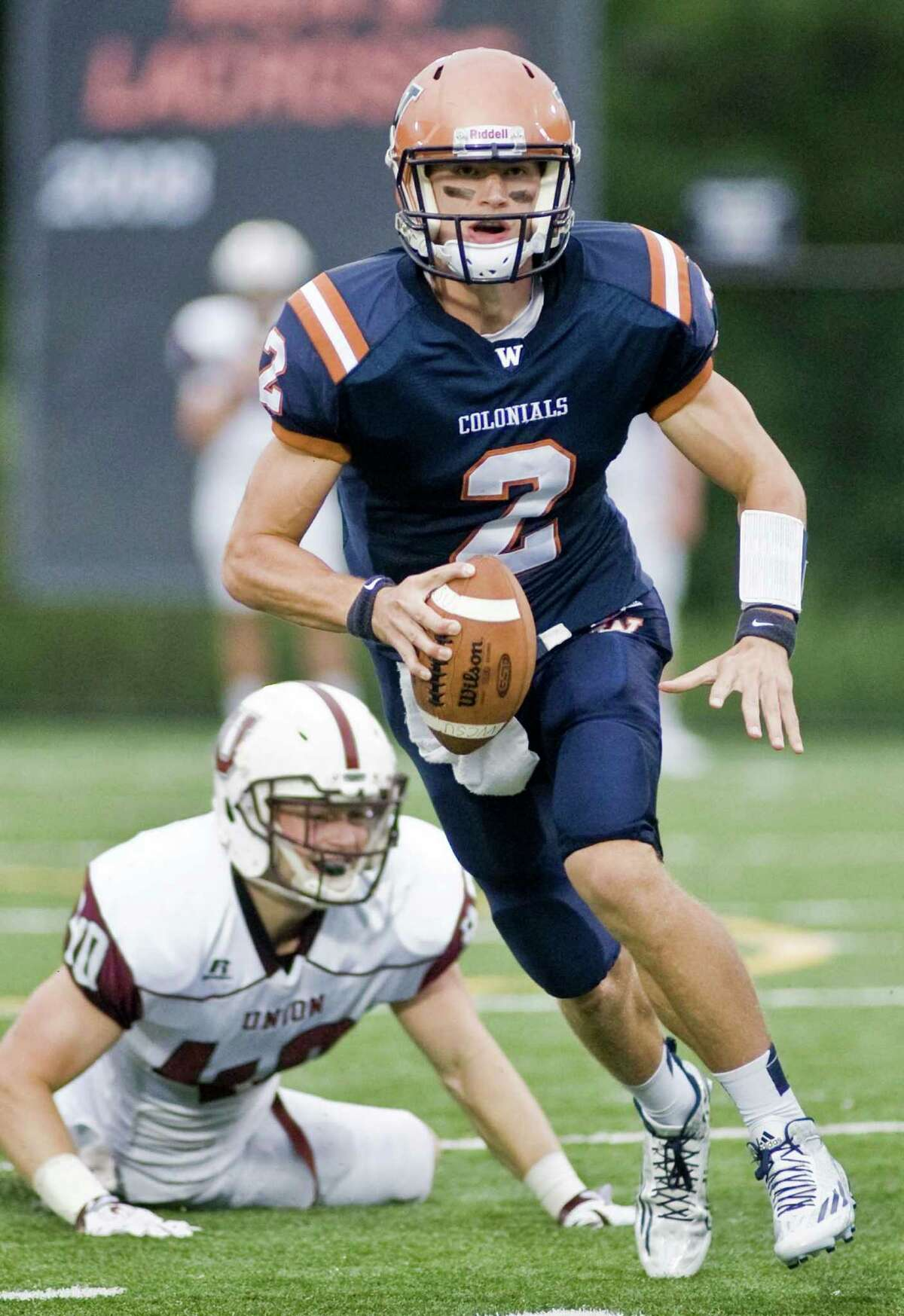 FILE PHOTO: WCSU Colonials quarterback Will Arndt looks for a receiver during a game against Union College, played at Western Connecticut State University Westside Athletic Complex. Saturday, Sept. 12, 2015