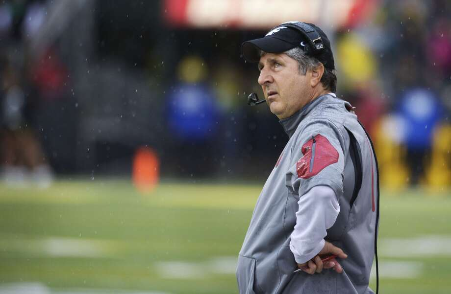 EUGENE, OR - Coach Mike Leach of the Washington State Cougars looks up at the video screen during the third quarter of the game against the Oregon Ducks at Autzen Stadium on October 10, 2015. (Photo by Steve Dykes/Getty Images)