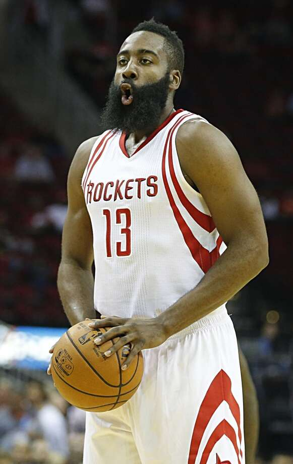 Houston Rockets guard James Harden prepares for a free throw during the first half of NBA game action against the New Orleans Pelicans at the Toyota Center Monday, Oct. 19, 2015, in Houston.