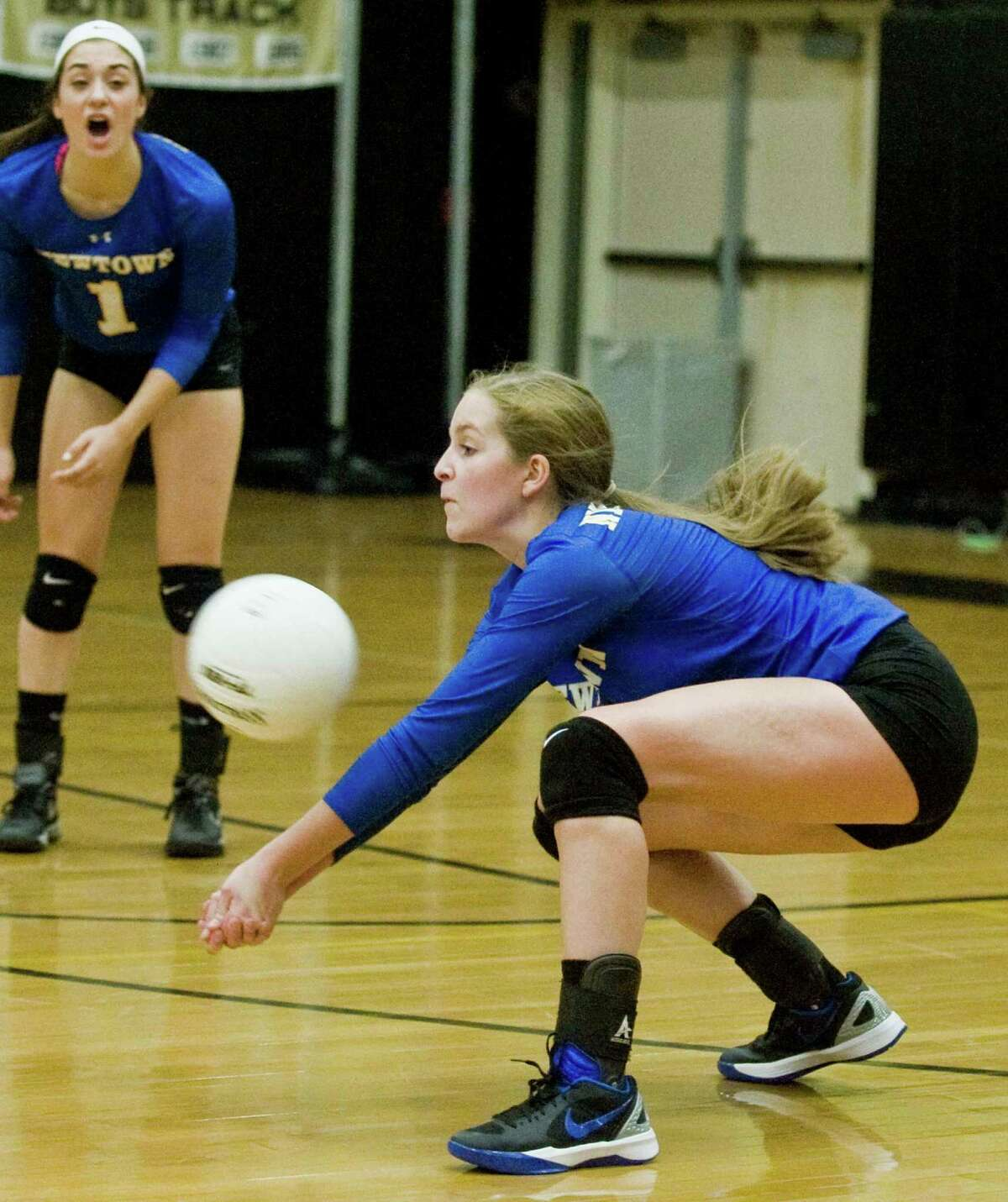 Newtown High School's Zoe Beals returns a serve in a game against Joel Barlow High School, played at Barlow. Monday, Oct. 19, 2015