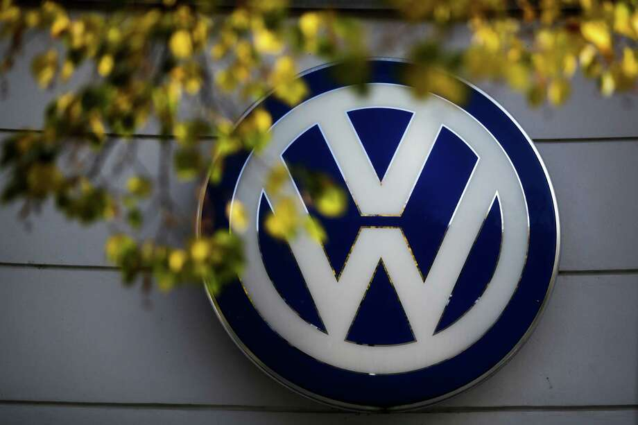 FILE - This Oct. 5, 2015 file photo shows the Volkswagen logo at the building of a company retailer in Berlin, Germany. Volkswagen almost inevitably will have to compensate owners of diesel cars equipped with emissions-rigging software. Some legal experts say the automaker could be forced to buy back the cars altogether. (AP Photo/Markus Schreiber, File) Photo: Markus Schreiber, STF / AP