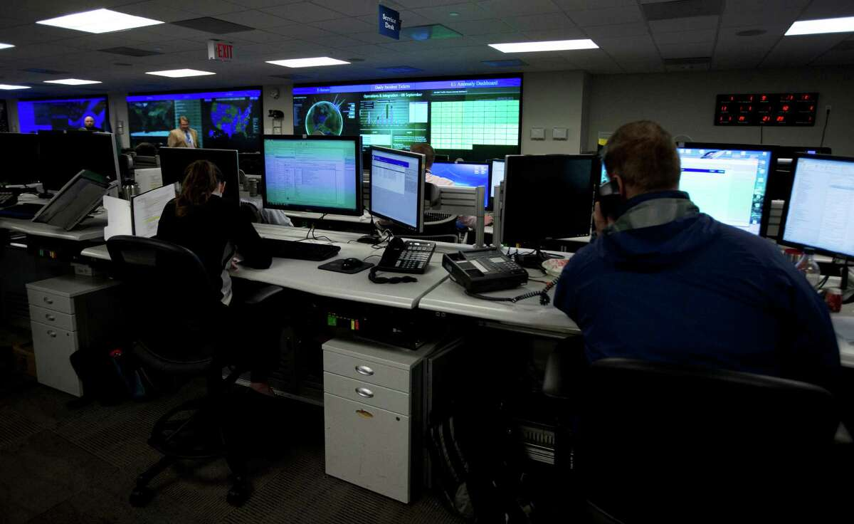 Specialists work to detect cyber-crime at the National Cyber- security and Communications Integration Center in Arlington, Va.