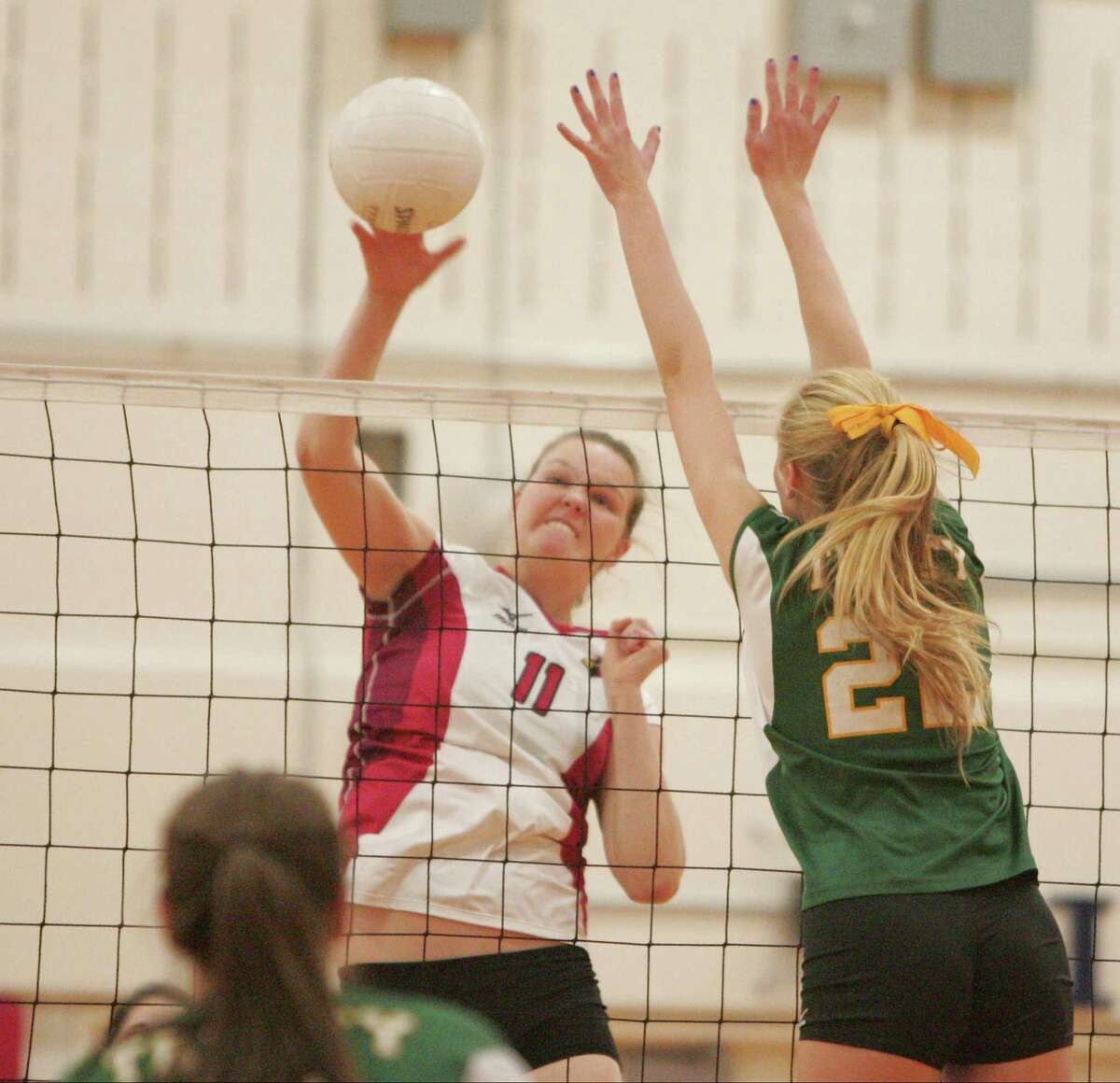 Greenwich's Abbie Wolf makes a hard return past the reach of Trinty's Riley Griffen in the second match. Greenwich went on to sweep Trinity Catholic, 25-21, 25-10, 25-12, running its record to 11-1 in the FCIAC match played in Greenwich.