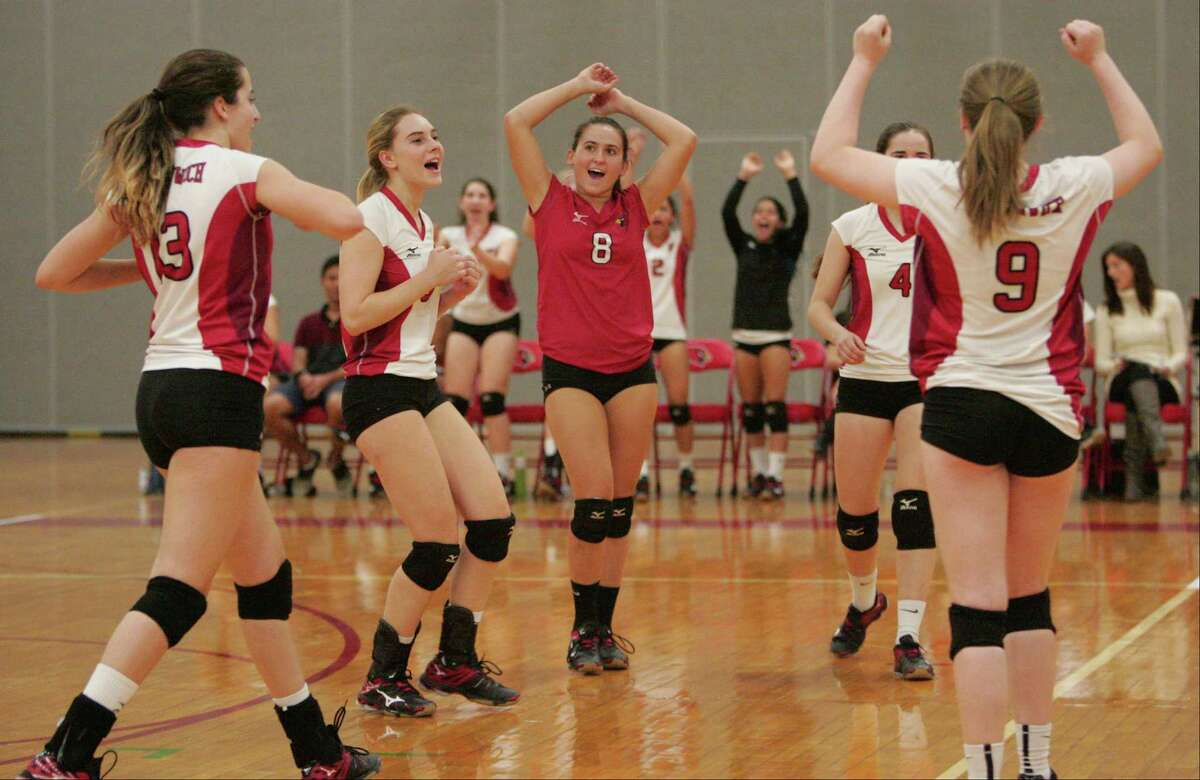 Greenwich players celebrate their sixth straight win.