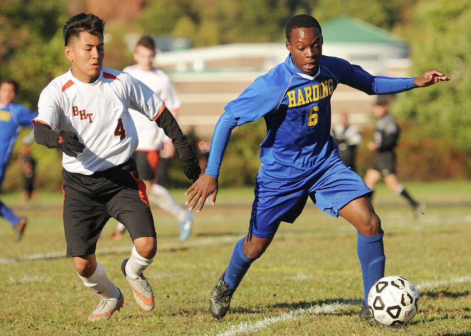Above, Harding's Darnell Ellis plays the ball in front of Bullard-Havens defender Jerry Xochicale during their game on Monday at Bullard0-Havens in Brigeport. Right, Bullard- Havens' Brayia n Marin races upfield. Photo: Brian A. Pounds / Hearst Connecticut Media / Connecticut Post