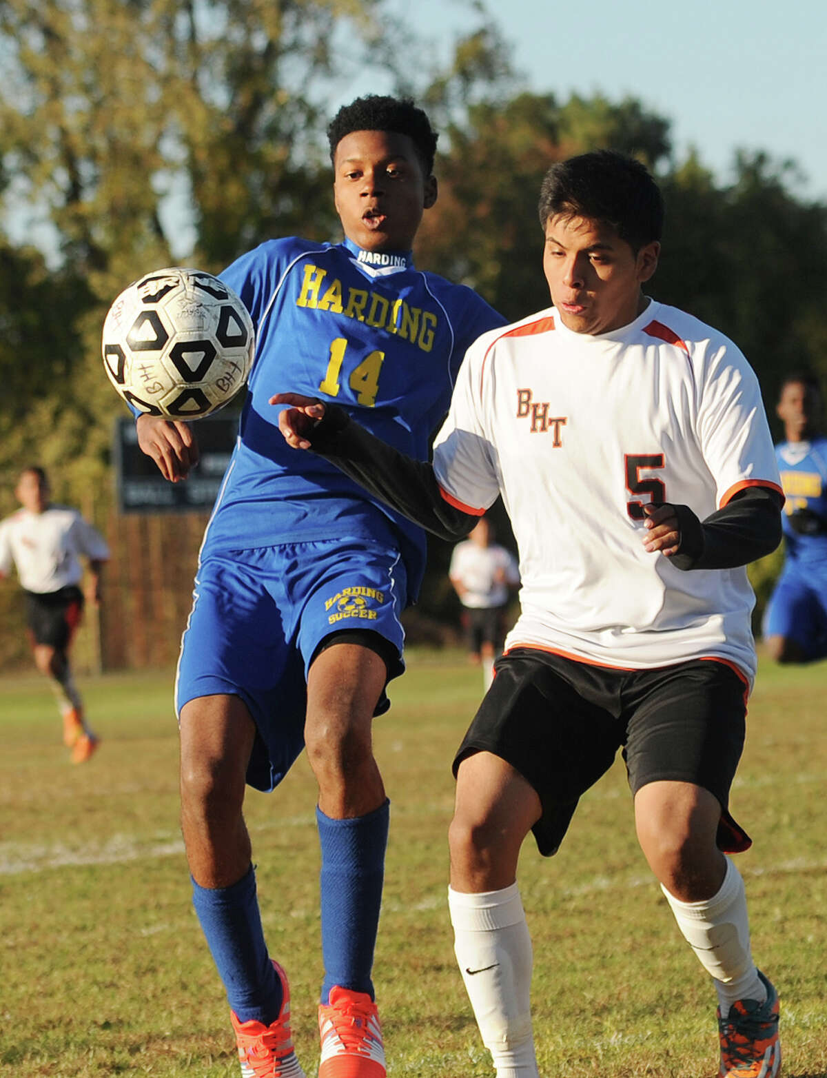 Harding's Sodique Allen battles for the ball with Bullard Havens' Danilo Lligicota during their boys soccer game at Bullard Havens Technical High School in Bridgeport, Conn. on Monday, October 19, 2015.
