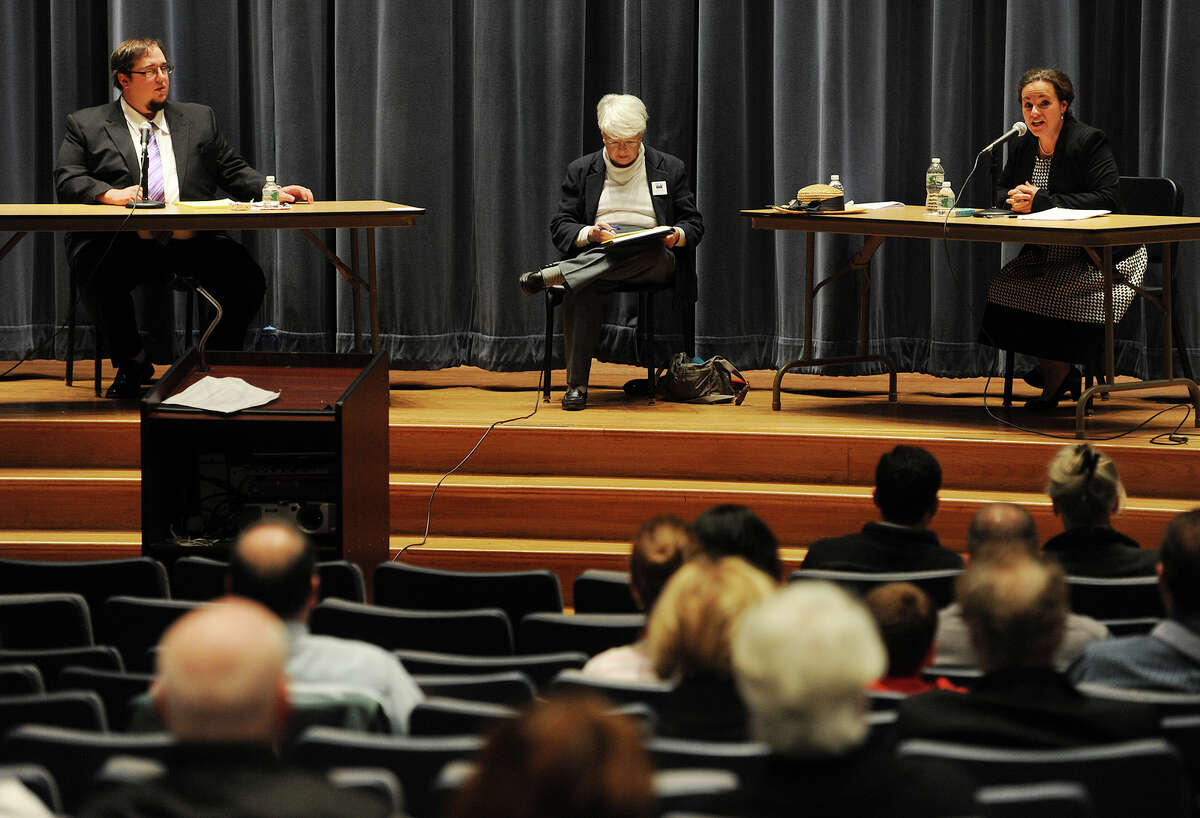 Shelton mayoral candidates Timothy Bristol, left, and Michele Bialek participate in the first Shelton mayoral debate at Shelton Intermediate School in Shelton, Conn. on Monday, October 19, 2015. Shelton Mayor Mark Lauretti chose not to participate in the debate.