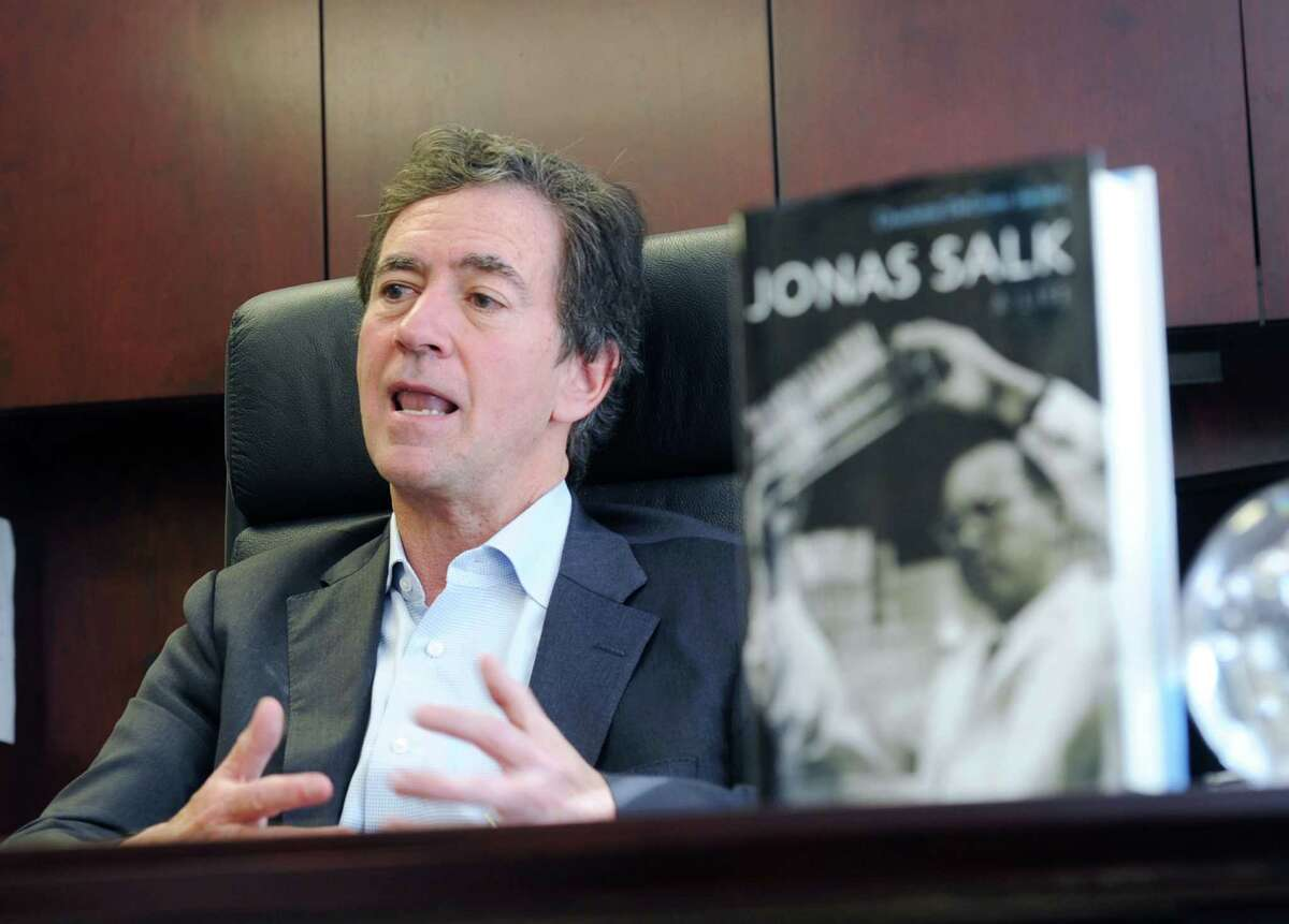 Kevin Kimberlin, chairman of Spencer Trask & Co., speaks about his late friend Jonas Salk during an interview in his Greenwich office. Salk, who died in 1995, developed the first successful polio vaccine.