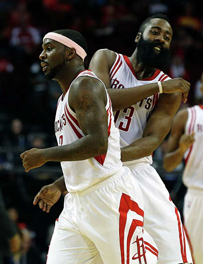 James Harden gives Ty Lawson a playful nudge after Lawson scored in the second half against New Orleans. The backcourt duo combined for 38 points. Photo: James Nielsen, Staff / © 2015  Houston Chronicle