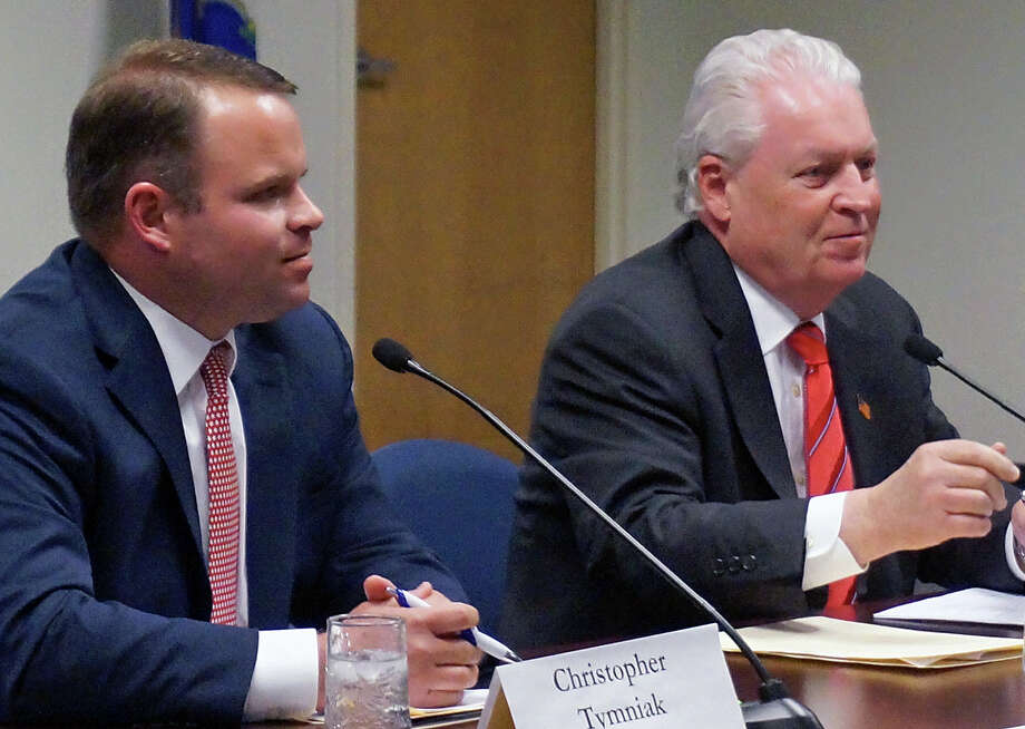 The first selectman candidates, Republican Chris Tymniak, left, and incumbent Democrat Mike Tetreau, faced off in the League of Women Voters' forum Monday night. Photo: Genevieve Reilly / Fairfield Citizen / Fairfield Citizen